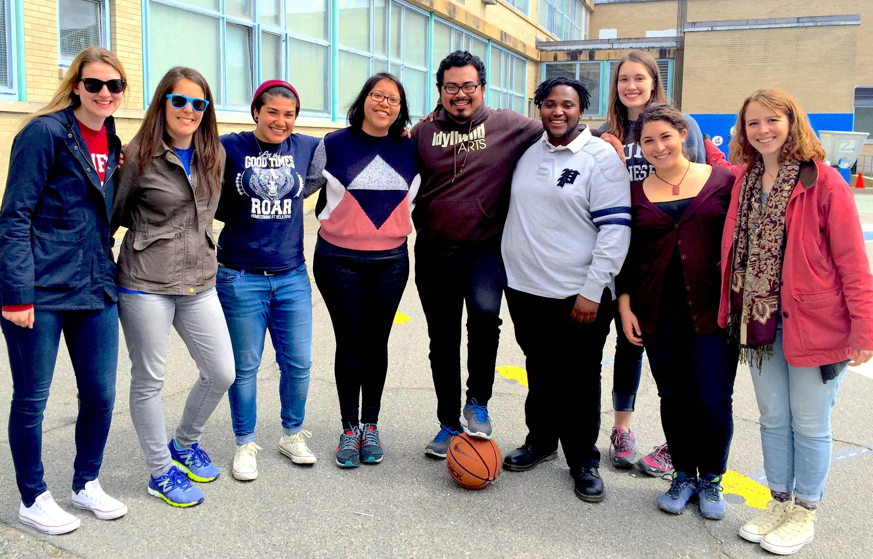 Group of fellows posing together in a schoolyard.
